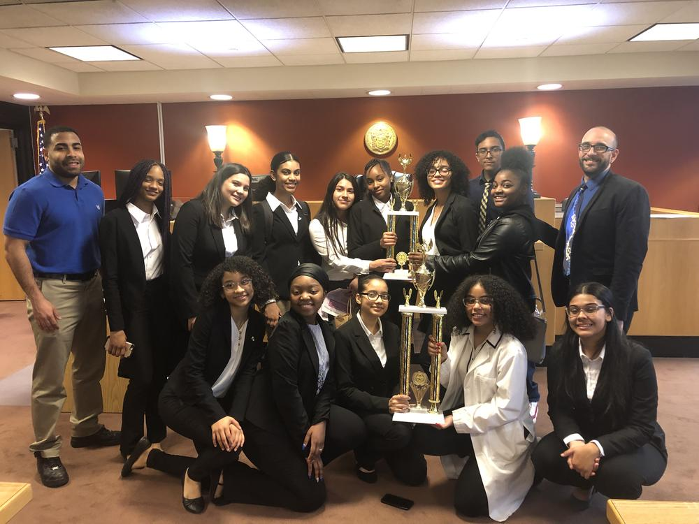 HARP Students holding mock trial trophies