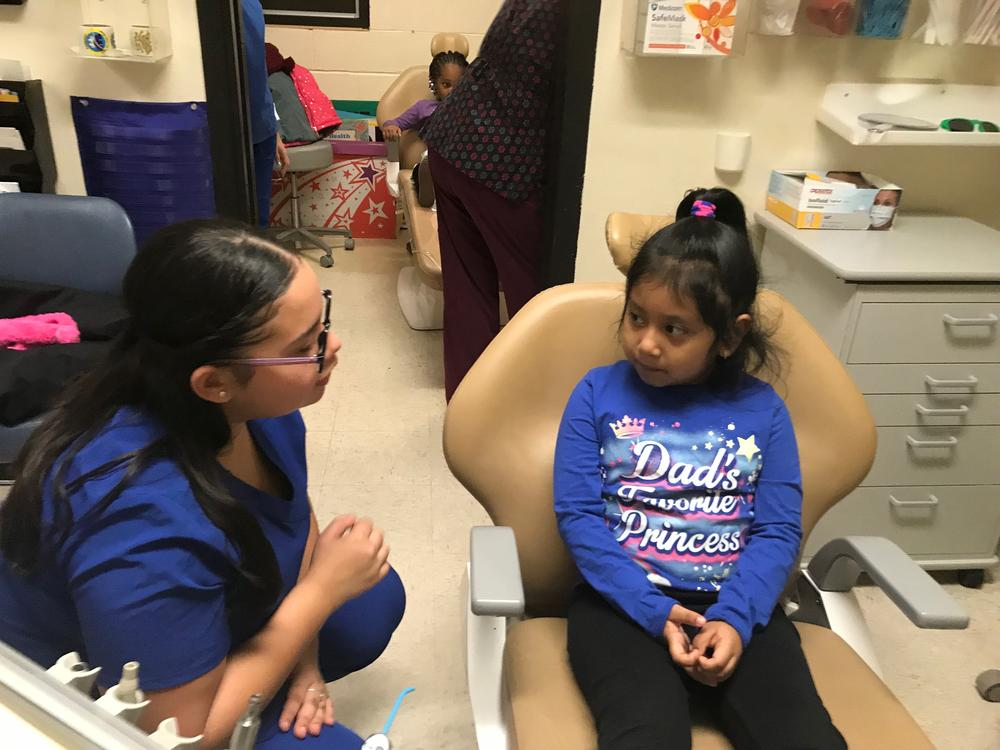HARP Dental student talking with elementary student